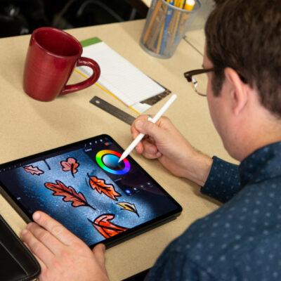 Jordan illustrating on iPad